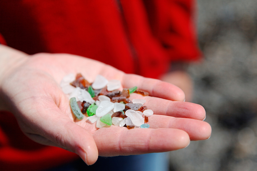 Woman's hand holding sea glass, Skagit County, Washington Park, Washington, USA