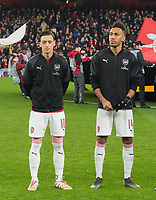Arsenal's Mesut Ozil and Pierre - Emerick Aubameyang before the UEFA Europa League match between Arsenal and Rennes at the Emirates Stadium, London, England on 14 March 2019. Photo by Andrew Aleksiejczuk / PRiME Media Images.