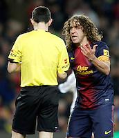 FC Barcelona's Carles Puyol have words with the referee Alberto Undiano Mallenco during Copa del Rey - King's Cup semifinal second match.February 26,2013. (ALTERPHOTOS/Acero) /Nortephoto