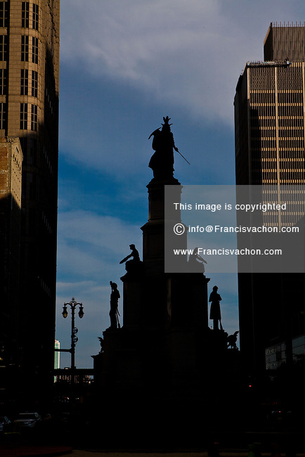 The Michigan Soldiers and Sailors Monument is silhouetted as the sun set  in Detroit (Mi) Saturday June 8, 2013.