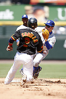 May 25, 2009:  Second Baseman Joe Dillon (15) of the Durham Bulls, International League Triple-A affiliate of the Tampa Bay Rays, tags out Alexi Casilla during a game at Frontier Field in Rochester, NY.  Photo by:  Mike Janes/Four Seam Images