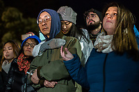 Hundreds of people showed up at a vigil at the Department of Homeland Security office in Cary, North Carolina Tuesday, November 27, 2018 to support Daniel Oliver Perez, after his father, Samuel Oliver-Bruno was detained to ultimately be deported to Mexico. The day after Thanksgiving, Friday November 23, Samuel Oliver-Bruno, a Mexican #immigrant living in #sanctuary at CityWell Church since late 2017, was lured to the U.S. Citizenship and Immigration Services office in Morrisville for a fingerprint appoint -- part of the process to have a stay on his deportation, and ultimately become a citizen. He was suddenly arrested by ICE agents. By Monday, November 26, he was in custody in Atlanta, his deferment was waived, and he was on his way to deportation. (Photo by Justin Cook)