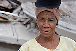 An earthquake survivor in Jacmel, a town on Haiti's southern coast that was ravaged by the January 12 earthquake, walks in front of rubble.