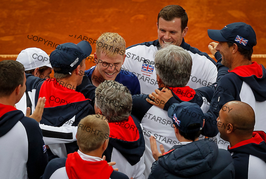 BELGRADE, SERBIA - JULY 17: Kyle Edmund (C) of Great Britain celebrate victory with the team captain Leon Smith (R) and team members against Serbia after day three of the Davis Cup Quarter Final match between Serbia and Great Britain on Stadium Tasmajdan on July 17, 2016 in Belgrade, Serbia. (Photo by Srdjan Stevanovic/Getty Images)