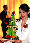 "October 12, 2017, Tokyo, Japan - A hotel clerk displays a Christmas tree shaped Christmas cake ""Sapin de Noel"" priced 18,000 yen at a press preview for the Prince Hotels chain's Christmas cake collection at the Prince Park Tower hotel  in Tokyo on Thursday, Octoebr 12, 2017. The hotel chain started to accept orders and will deliver before Christmas Day.   (Photo by Yoshio Tsunoda/AFLO) LWX -ytd-"