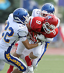 SIOUX FALLS, SD - SEPTEMBER 7:  Trevor Naasz #9 from Lincoln is brought down by Chris Sharpe #22 and Easton Schuster #20 from O'Gorman in the first quarter of their game at the 2013 Presidents Bowl at Howard Wood Field. (Photo by Dave Eggen/Inertia)