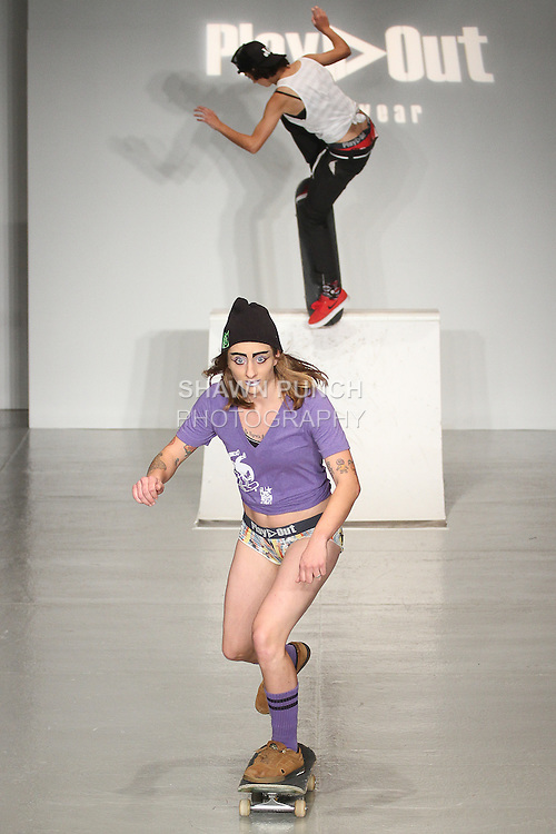Celina Meehan from All Girl Skate Jam, skates on runway for the Play Out Underwear Spring Summer 2015 collection by Sylvie Lardeux and Abby Sugar, during LingerieFW Spring Summer 2015.