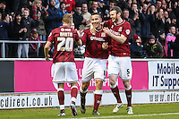 Rod McDonald of Northampton Town (centre) celebrates scoring his team's third goal against Morecambe with Zander Diamond of Northampton Town (right) and Lee Martin of Northampton Town (left) during the Sky Bet League 2 match between Northampton Town and Morecambe at Sixfields Stadium, Northampton, England on 23 January 2016. Photo by David Horn / PRiME Media Images.