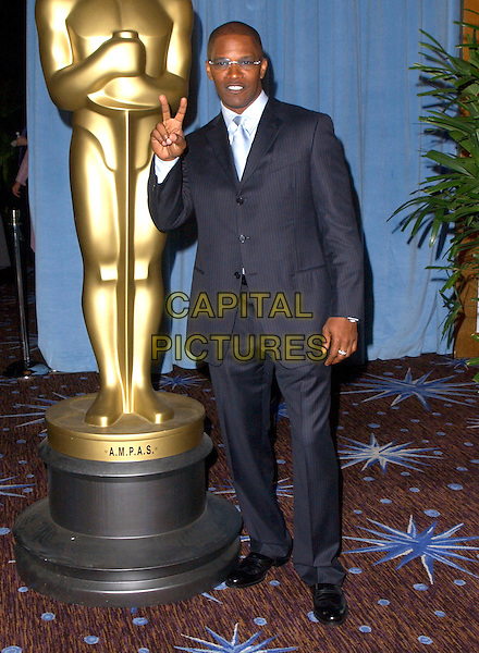 JAMIE FOXX.Attends The 77th Annual Academy Awards Nominees Luncheon held at The Beverly Hilton Hotel,.Beverly Hills, California, USA, .February 7th 2005..full length fingers peace sign gesture glasses lunch.Ref: DVS.www.capitalpictures.com.sales@capitalpictures.com.©Capital Pictures.