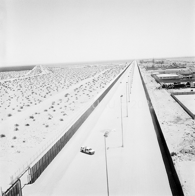 San Luis, Arizona<br /> May 1, 2008<br /> <br /> US Border Patrol flies over the new double layered wall/fence on the US/Mexican border. The left is the United States and Mexico is on the right. This fence has cut illegal crossing substantially in the past 6 months many of the crossings pushing out toward the Tucson sector.