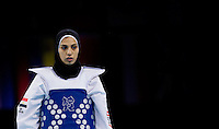 10 AUG 2012 - LONDON, GBR - Seham el-Sawalhy (EGY) of Egypt waits for the start of the next round during her women's -67kg category preliminary round Taekwondo contest against Elin Johansson of Sweden at the London 2012 Olympic Games at Excel in London, Great Britain (PHOTO (C) 2012 NIGEL FARROW)