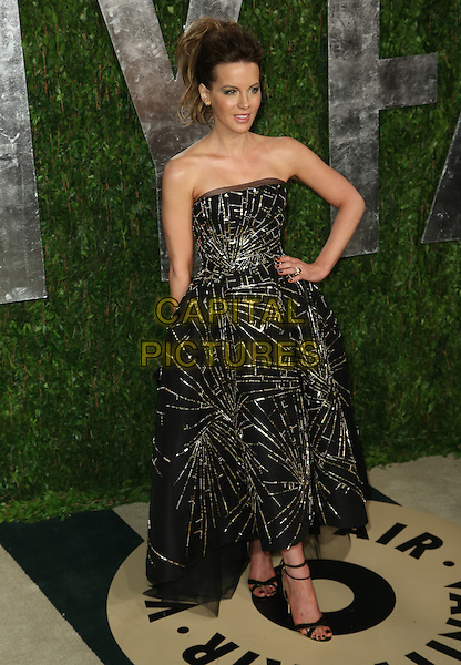 Kate Beckinsale.2013 Vanity Fair Oscar Party following the 85th Academy Awards held at the Sunset Tower Hotel, West Hollywood, California, USA..February 24th, 2013.oscars full length dress black gold beads beaded strapless hand on hip.CAP/ADM/SLP/DOW.©Dowling/StarlitePics/AdMedia/Capital Pictures
