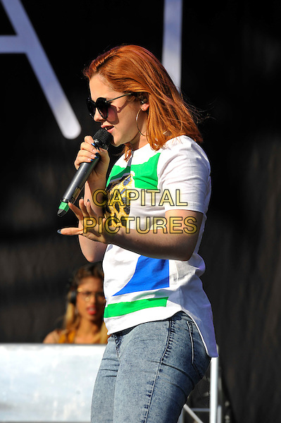 Katy B (Kathleen Anne Brien).performing at 'As One In The Park' festival, Victoria Park, London, England. 26th May 2013.on stage in concert live gig performance music half length jeans denim singing white top sunglasses shades blue green leopard print side profile .CAP/MAR.© Martin Harris/Capital Pictures.