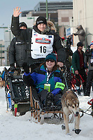 Dallas Seavey and team leave the ceremonial start line with an Iditarider at 4th Avenue and D Street in downtown Anchorage, Alaska on Saturday, March 5th during the 2016 Iditarod race. Photo by Joshua Borough/SchultzPhoto.com