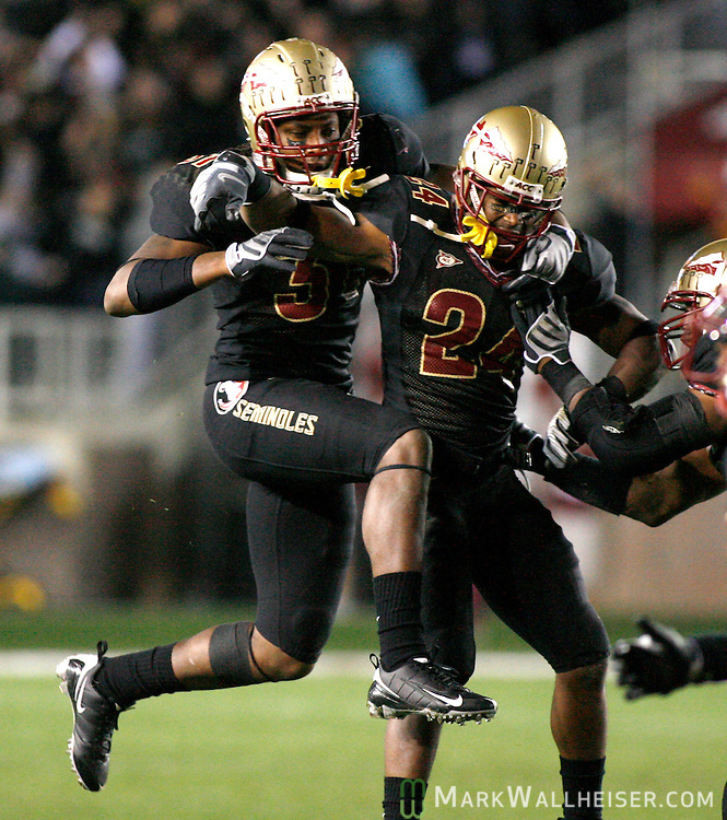 Darius McClure (R) injures himself celebrating his interception with Doddrick Verdellin the 2nd half of Florida State's NCAA football game against  Boston College at Bobby Bowden field on the Florida State University campus in Tallahassee, Florida November 15, 2008.  (Mark Wallheiser/TallahasseeStock.com)