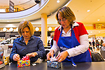 Dec. 12, 2012 - Garden City, New York, U.S. - L-R, BARBARA MEYER, of Woodbury, and EILEEN GONZALEZ of Northport, help the Merrick Kiwanis Club, a community service group, gift wrap presents at Roosevelt Field mall in Long Island to help raise funds to use for charity, during the busy winter holiday shopping season. They were among members of Meadowbrook Women's Initiative helping at the booth. Some ways Kiwanis helps the community are by providing food, clothing, and school supplies to those in need, sending children to Kamp Kiwanis, providing scholarships and hosting a Harvest Ball for senior citizens.