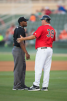 Kannapolis Intimidators manager Tommy Thompson (39) argues a call with base umpire Christopher Lloyd during the game against the Delmarva Shorebirds at CMC-Northeast Stadium on June 6, 2015 in Kannapolis, North Carolina.  The Shorebirds defeated the Intimidators 7-2.  (Brian Westerholt/Four Seam Images)