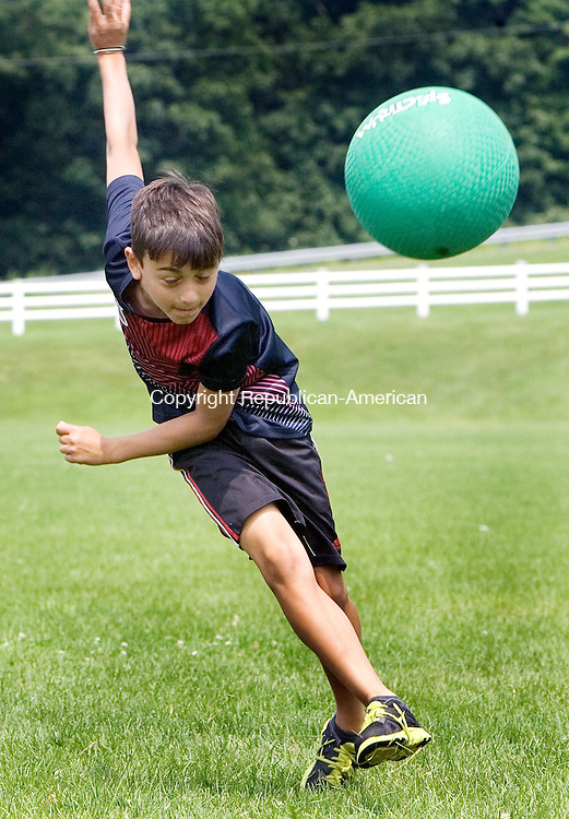 MIDDLEBURY CT. 06 July 2015-070615SV05-Matteo DelBuono, 8, of Middlebury takes a shot on goal while playing soccer at playground camp sponsored by Park and Recreation in Meadowview Park in Middlebury Monday.<br /> Steven Valenti Republican-American