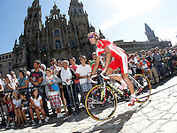 Egoitz Garcia passes by the front of the Obradoiro of the Cathedral of Santiago de Compostela before the stage of La Vuelta 2012 between Santiago de Compostela and Ferrol.August 31,2012. (ALTERPHOTOS/Acero)