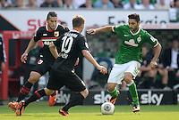 FUSSBALL   1. BUNDESLIGA   SAISON 2013/2014   2. SPIELTAG SV Werder Bremen - FC Augsburg       11.08.2013 Raul Bobadilla (li) und Daniel Baier (Mitte, beide FC Augsburg) gegen Mehmet Ekici (re, SV Werder Bremen)