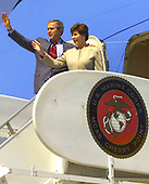 United States President George W. Bush and first lady Laura Bush approach the podium at W.P.T. Hill Field at Camp Lejeune, North Carolina on April 3, 2003.  The President addressed more than 20,000 service and family members, ate lunch with Marines and sailors, and met with family members who lost loved ones in Operation Iraqi Freedom during his visit. <br /> Mandatory Credit: Donald E. Preston / DoD via CNP