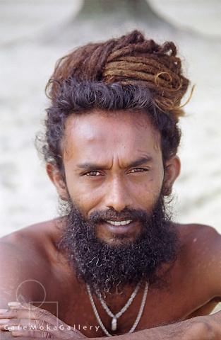 Portrait of an Indo-Trinidadian man with Dreadlocks at Maracas Beach, Trinidad