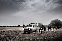 "South Sudan. 23 March 2011...Health Workers in the italian NGO ""Cuamm - Medici con l'Africa"", installing a mobile clinic for the vaccination of children from a Dinka cattle camp.."