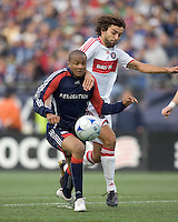 New England Revolution defender Darrius Barnes (25) and Chicago Fire midfielder Baggio Husidic (9) battle for a crossed ball. The New England Revolution out scored the Chicago Fire, 2-1, in Game 1 of the Eastern Conference Semifinal Series at Gillette Stadium on November 1, 2009.