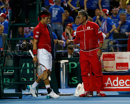 06.03.2016. Barclaycard Arena, Birmingham, England. Davis Cup Tennis World Group First Round. Great Britain versus Japan. Japan team captain Minoru Ueda and Kei Nishikori after Nishikori has won the third set.