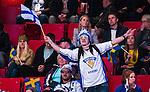 Stockholm 2014-05-03 Ishockey Oddset Hockey Games  Sverige - Finland :  <br /> Finsk supporter med en flagga p&aring; l&auml;ktaren under matchen<br /> (Foto: Kenta J&ouml;nsson) Nyckelord:  Oddset Hockey Games Sverige Swe Tre Kronor Finland Fin Globen Ericsson Globe Arena supporter fans publik supporters