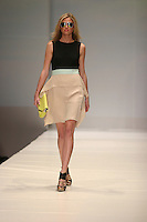 HOUSTON, TX - NOVEMBER 12 : A Model walks the runway during a BCBGMAXAZRIA show on day one of Fashion Houston Spring 2013 Presented By Audi at the Wortham Theatre Center on November 12, 2012 in Houston, Texas. (Photo by Louis Dollagaray/MediaPunch Inc.) /NortePhoto