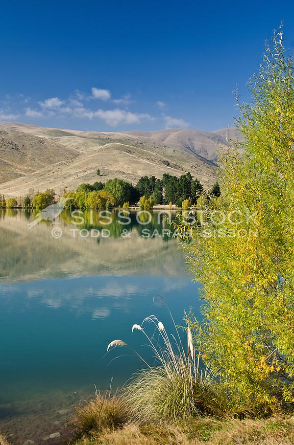 Autumn mirror reflection in a  pond near Twizel, South Island, New Zealand - stock photo, canvas, fine art print
