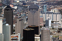 aerial photograph of JP Morgan Chase tower at center and the city skyline and huge Infinity billboard on building side heavy traffic approaching city in background Dallas, Texas