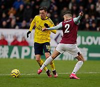 2nd February 2020; Turf Moor, Burnley, Lancashire, England; English Premier League Football, Burnley versus Arsenal; Mesut Ôzil of Arsenal rounds Matthew Lowton of Burnley