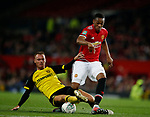 Tom Naylor of Burton Albion tackles Anthony Martial of Manchester United during the Carabao Cup Third Round match at the Old Trafford Stadium, Manchester. Picture date 20th September 2017. Picture credit should read: Simon Bellis/Sportimage