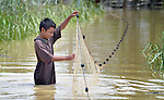 A boy check his fishing net in a flooded field in the village of Kubang Gajah in Indonesia's Aceh province. In November 2014 the village experienced the worst flooding in memory, something many local residents blamed on the expansion of nearby palm oil plantations.