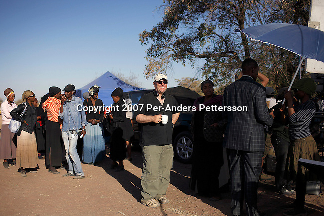 GABORONE, BOTSWANA - AUGUST 18: Anthony Minghella (l), the Oscar-winning director, drinks a cup of coffee before a funeral scene on the set of The No 1 Ladies Detective Agency on August 18, 2007 in Gaborone, Botswana. The film is based on Alexander McCall Smith?s best-selling series. Mr. Minghella and his crew filmed for months around Botswana and the Government of Botswana has invested $US5 Million in the project. (Photo by Per-Anders Pettersson/Getty Images)...