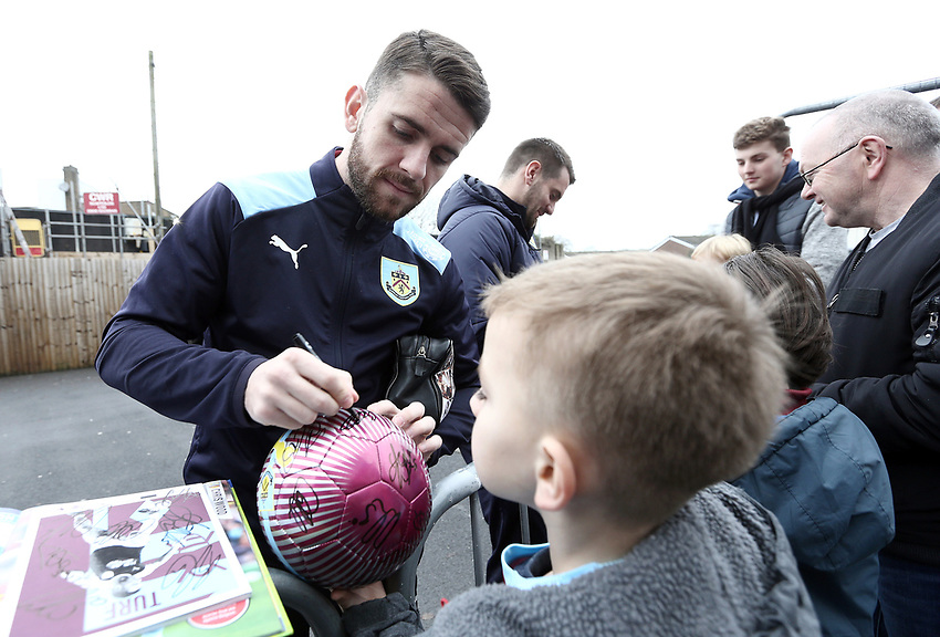 Burnley players stop to sign autographs for the waiting fans as they arrive at Turf Moor ahead of kick-off,  <br /> <br /> Photographer Rich Linley/CameraSport<br /> <br /> The Premier League - Burnley v Everton - Wednesday 26th December 2018 - Turf Moor - Burnley<br /> <br /> World Copyright © 2018 CameraSport. All rights reserved. 43 Linden Ave. Countesthorpe. Leicester. England. LE8 5PG - Tel: +44 (0) 116 277 4147 - admin@camerasport.com - www.camerasport.com