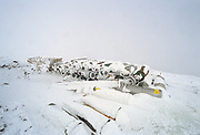 Appalachian Trail - A row of tanks at Lakes of the Clouds Hut in whiteout conditions along the Crawford Path in the White Mountain National Forest of New Hampshire USA. These tanks are no longer stored like this at the hut