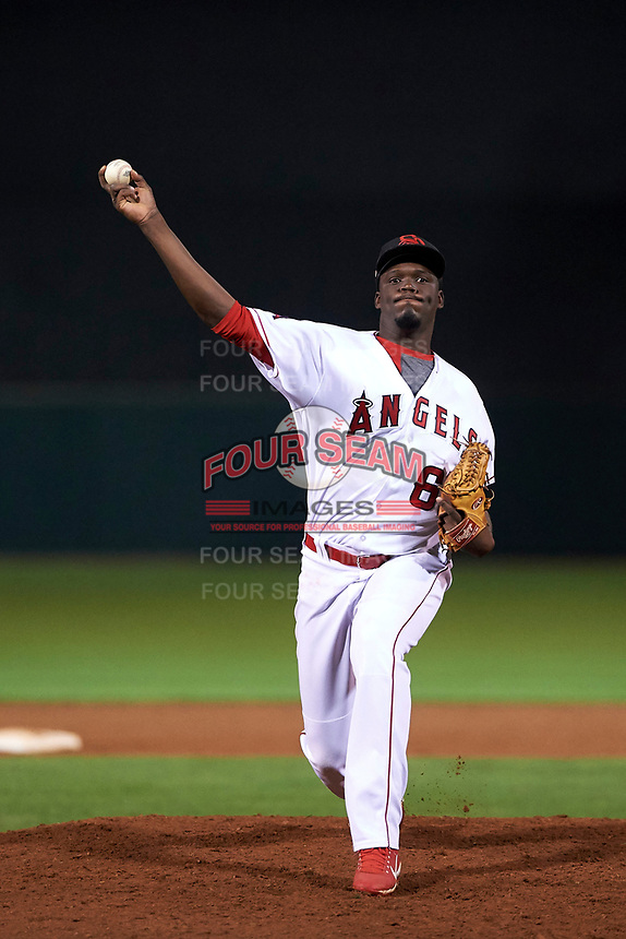 Scottsdale Scorpions relief pitcher Samil De Los Santos (61), of the Los Angeles Angels organization, delivers a pitch to the plate during an Arizona Fall League game against the Mesa Solar Sox on October 23, 2017 at Scottsdale Stadium in Scottsdale, Arizona. The Solar Sox defeated the Scorpions 5-2. (Zachary Lucy/Four Seam Images)