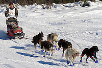 Musher Michael Williams Jr. on Long Lake at the Re-Start of the 2011 Iditarod Sled Dog Race in Willow, Alaska.