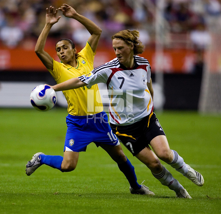 Germany midfielder (7) Melanie Behringer takes the ball away from Brazil forward (10) Marta during the FIFA Women's World Cup final at Hongkou Stadium in Shanghai, China on September 30, 2007.  Germany defeated Brazil, 2-0.