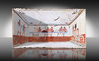 "Reconstruction of  the inside of the Greek Tomb of  the Diver  [La Tomba del Truffatore] from the Greek city of Poseidonia which became Roman Paestum. .   The rear panel is from one of the long sides of the tomb and shows a symposium of men lying on couches facing low tables on which goblets have been placed.  The abondon experienced at the Synposium was one way in which the dead could access the next world .  The fresco on the lid of the tomb and shows a  diving from a column into water. The column represents the border of thye known world and therefore the limit of man's knowledge.  The dive represents the passage form this world to the next. The tomb is painted with the true fresco technique and its importance lies in being ""the only example of Greek painting with figured scenes dating from the Orientalizing, Archaic, or Classical periods to survive in its entirety. Paestrum, Andriuolo.  (480-470 BC  )"