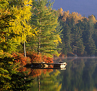 AJ1994, Maine, fall, lake, reflection, Baxter State Park, The early morning sun shines on the calm water of Daicey Pond in Baxter State Park in the fall. A dock and the colorful fall foliage reflect in the quiet water.
