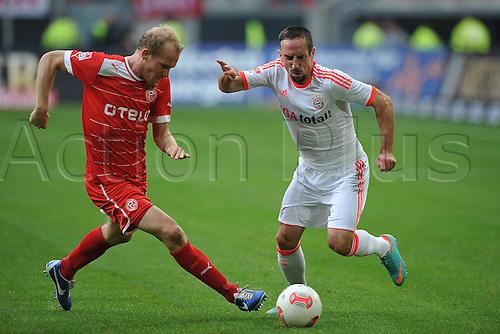 20.10.2012. Dusseldorf, Germany.  Dusseldorf versus  FC Bayern Munich. Tobias Levels Dusseldorf left Franck Ribery Munich right