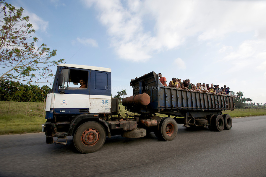 Because of the US embargo, Cuba has not so much gas and petrol. Trucks are often used as public transport.