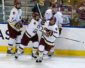Carl Sneep (BC - 7), Cam Atkinson (BC - 13), Brian Dumoulin (BC - 2) and Brian Gibbons (BC - 17) celebrate Gibbon's goal. - The Boston College Eagles defeated the Yale University Bulldogs 9-7 in the Northeast Regional final on Sunday, March 28, 2010, at the DCU Center in Worcester, Massachusetts.