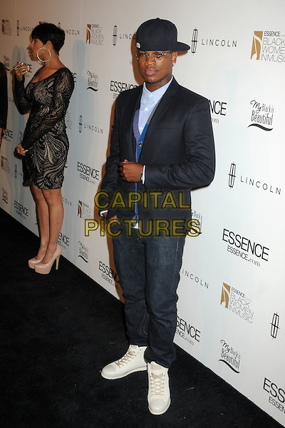 Ne-Yo (Shaffer Chimere Smith, Jr.).3rd Annual Essence Black Women In Music Event held at the Belasco Theatre, Los Angeles, California, USA..February 8th, 2012.full length suit jacket blue shirt baseball cap hat glasses jeans denim white trainers sneakers  .CAP/ADM/BP.©Byron Purvis/AdMedia/Capital Pictures.