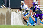 Los Angeles, CA 02/15/14 - Brody Lundquist (Washington #28) and Zachary Winters (UCLA #15) in action during the Washington versus UCLA  game as part of the 2014 Pac-12 Shootout at UCLA.  UCLA defeated Washington 13-7.