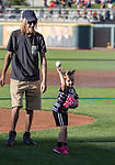 "Caddie Lapier throws out the first pitch with help from dad Casey during the Reno Aces ""Star Wars Night"" game at Greater Nevada Field in Reno on Saturday, June 17, 2017."